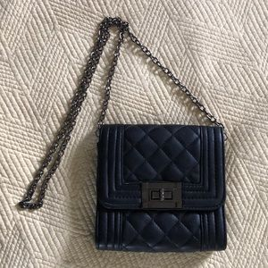 Faux leather quilted mini handbag